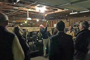 Craig Curley, chairman of the Clubhouse Building Committee Members, gives the Board of Finance a tour of the clubhouse.
