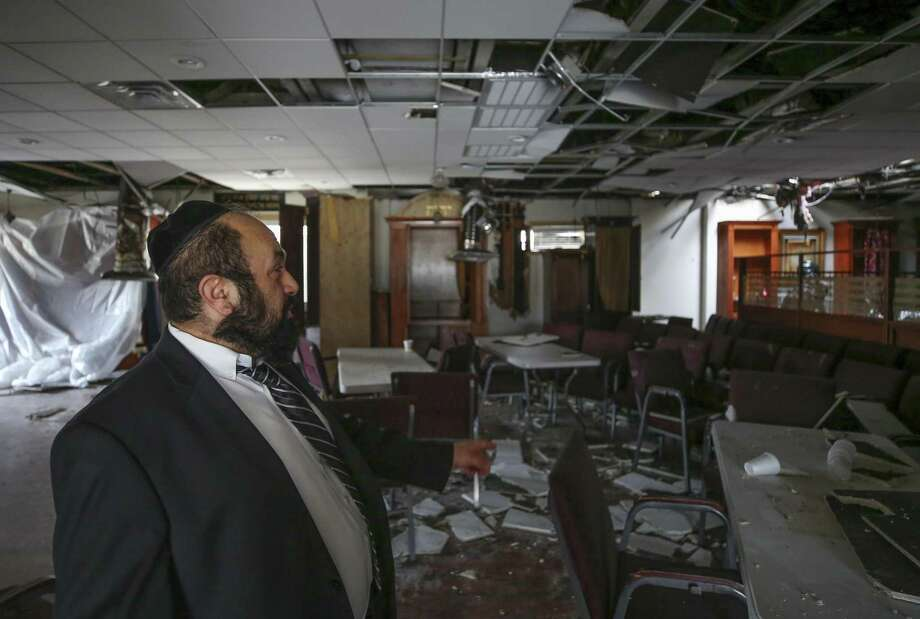 Torah Vachesed rabbi Ivraham Yaghobian looks at the damage caused by Wednesday night's fire in Houston. The fire appears have started on the back side of the building. The Houston Fire Department arson unit is investigating what cause the blaze. Photo: Godofredo A. Vasquez, Houston Chronicle / Staff Photographer / 2018 Houston Chronicle