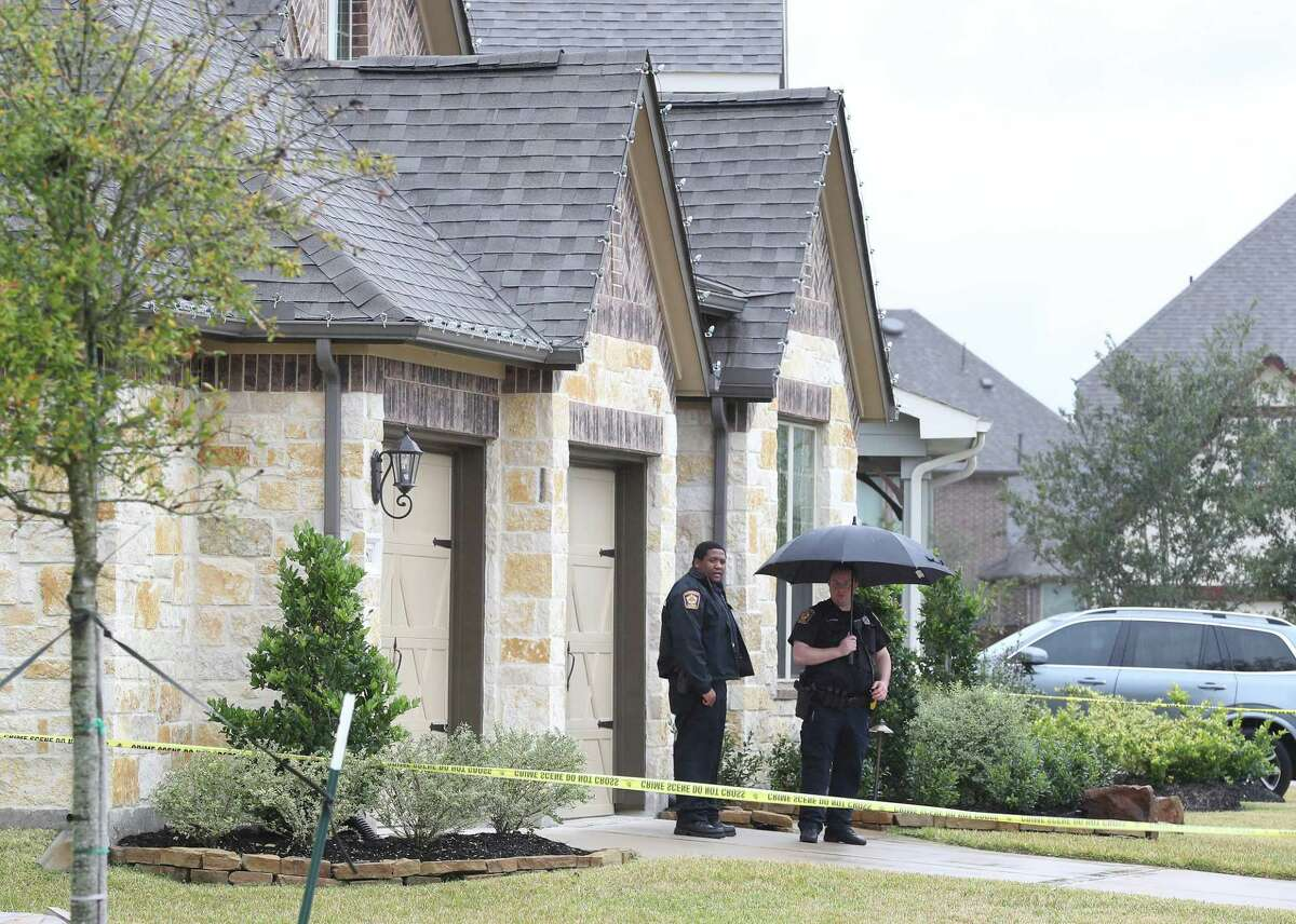 Investigators work the scene where a homeowner was killed during what is believed to have been a home invasion in the 10800 block of Gates Randall Court Thursday, Nov. 29, 2018, in Cypress.