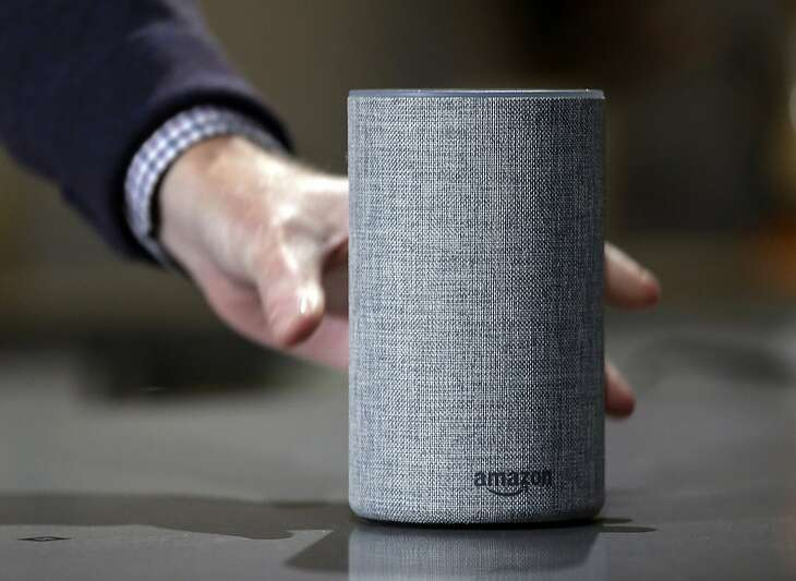 """FILE - In this Sept. 27, 2017, file photo, a new Amazon Echo is displayed during a program announcing several new Amazon products by the company, in Seattle. Big Mouth Billy Bass is programmed to respond to Alexa voice commands through a compatible Amazon Echo device. That means the singing and talking fish will lip synch to Alexa's responses and will dance to songs from Amazon music. When it's first plugged in, it will respond """"Woo-hoo, that feels good!"""" (AP Photo/Elaine Thompson, File)"""