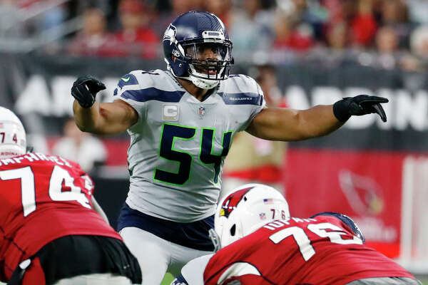 FILE - In this Sept. 30, 2018, file photo, Seattle Seahawks linebacker Bobby Wagner (54) gestures at the line of scrimmage during an NFL football game against the Arizona Cardinals in Glendale, Ariz. Seattle (6-5) has won two straight and has a direct path to an NFC playoff berth in a season no one really expected them to be in the conversation at the beginning of December.