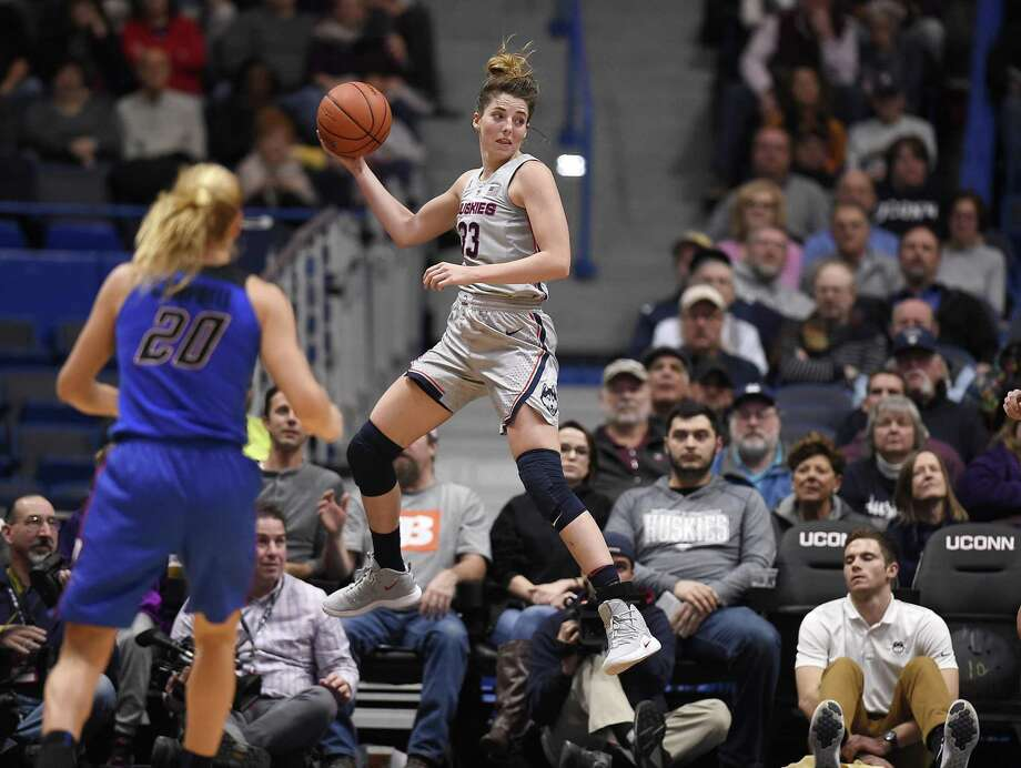 UConn's Katie Lou Samuelson leaps to keep a ball in play as DePaul's Kelly Campbell (20) looks on during Wednesday's win at the XL Center in Hartford. Photo: Jessica Hill / Associated Press / Copyright 2018 The Associated Press. All rights reserved