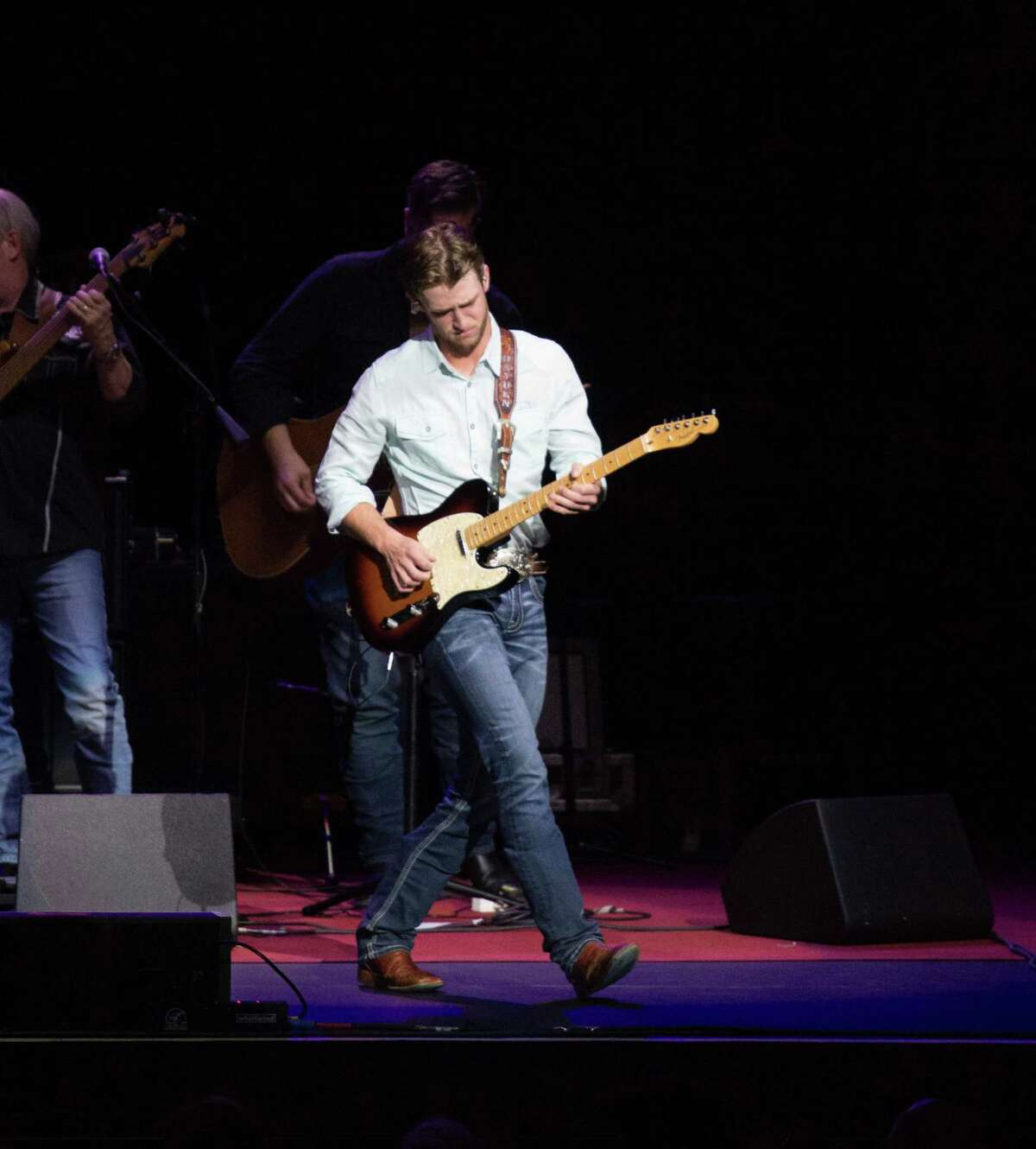 Hayden Baker performs before country legend Willie Nelson at the Smart Financial Centre in Sugar Land.