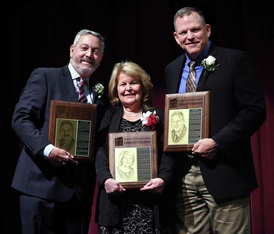 From left, Larry Lazaroff, Linda Battalene and David Mikos are photographed with their Community Star Awards from the North Haven Education Foundation at North Haven Middle School on November 28, 2018. Photo: Arnold Gold / Hearst Connecticut Media / New Haven Register