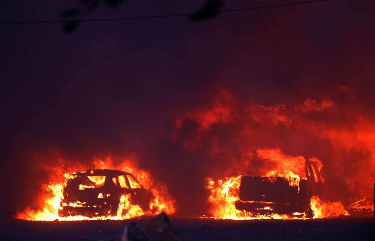 Vehicles burn during Camp Fire in Paradise, Calif.. on Thursday, November 8, 2018.