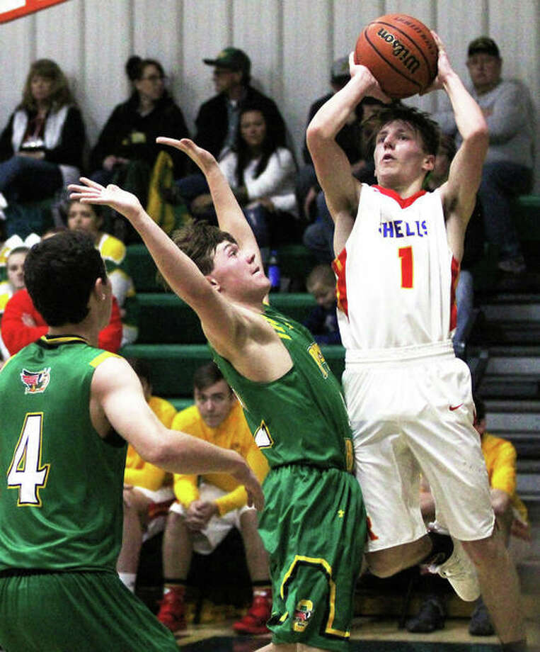 Roxana's Andrew Beckman (right) pulls up to shoot over Southwestern's E.J. Kahl (middle) during a Shells' win at the Metro-East Lutheran Tournament last Friday at Hooks Gym in Edwardsville. Photo: Greg Shashack / The Telegraph