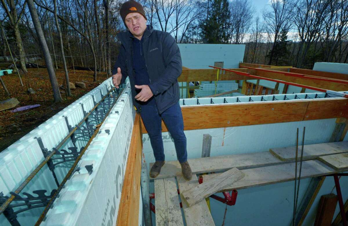 Paul Gudas, Sky View Builders Project Manager, shows the forms used on Gudas' ICF (Insulated Concrete Forms) home Thursday, November 29, 2018, in Westport, Conn. ICF is a decades-old construction method that is resistant to tornadoes, hurricanes, earthquakes, fire, termites and rodents, and also reduces outside air infiltration, is environmentally-friendly and saves on energy costs, but is still relatively unknown in Connecticut.