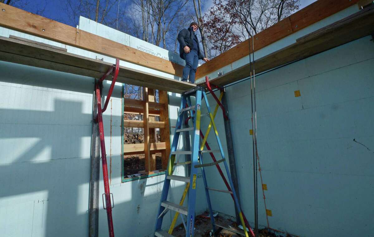 Paul Gudas, Sky View Builders Project Manager, shows the forms on Gudas' ICF (Insulated Concrete Forms) home Thursday, November 29, 2018, in Westport, Conn. ICF is a decades-old construction method that is resistant to tornadoes, hurricanes, earthquakes, fire, termites and rodents, and also reduces outside air infiltration, is environmentally-friendly and saves on energy costs, but is still relatively unknown in Connecticut.