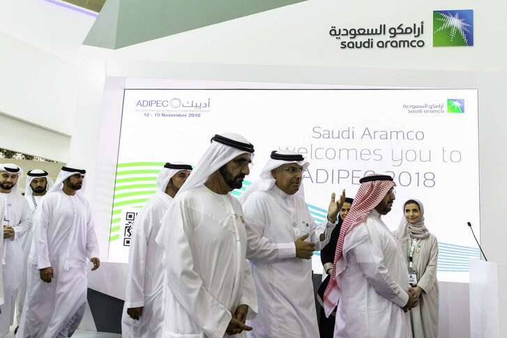 Mohammed bin Rashid Al Maktoum, the ruler of Dubai, center, tours the Saudi Aramco exhibition area during the Abu Dhabi International Petroleum Exhibition & Conference in Abu Dhabi, United Arab Emirates on Nov. 13.. OPECs secretary-general, energy ministers from Saudi Arabia to Russia, CEOs at oil majors from Total SA, BP Plc and Eni SpA, and officials from Middle Eastern energy giants such as Abu Dhabis Adnoc have gathered to sign deals and discuss oil, gas, refining and petrochemical issues.