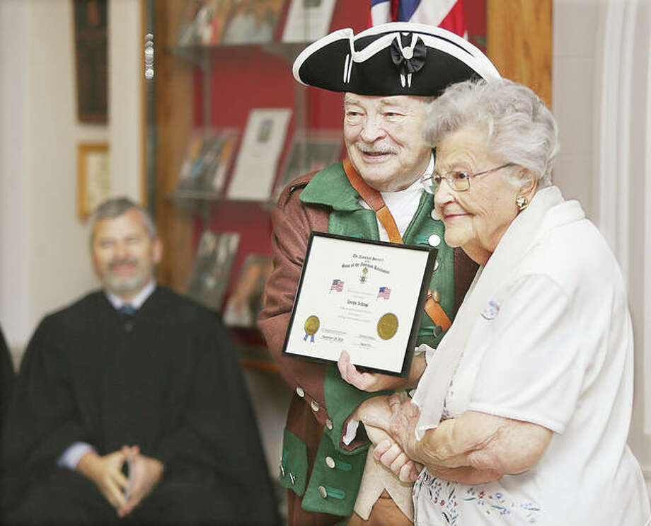 Evelyn Schrage, right, seemed happy to pose for a photo Thursday as this year's Edwardsville Township award recipient at the 22nd annual Flag Award Ceremony held in the Madison County Courthouse by the General George Rogers Clark Chapter of the Sons of the American Revolution. Schrage smiles with alongside a chapter member. Photo: John Badman | Heart Illinois