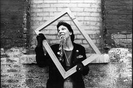 Dana Rudolph, posing with silver necklaces (photo by Anthony Tassarotti), circa 1979-80