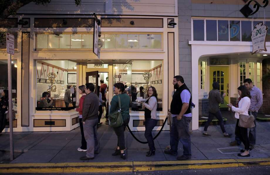FILE -- Customers line up outside Ici Ice Cream shop on College Avenue in Berkeley, Calif., on July 10, 2013.