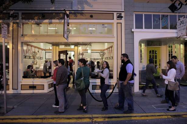 Customers line up outsides Ici Ice Cream shop on College Avenue in Berkeley, Calif., on Wednesday, July 10, 2013. The shop is extremely popular in the neighborhood and frequently has lines down the block. The Elmwood district of Berkeley has become one of the most affluent, prosperous neighborhoods in the East Bay, following a revitalization by the City of Berkeley.
