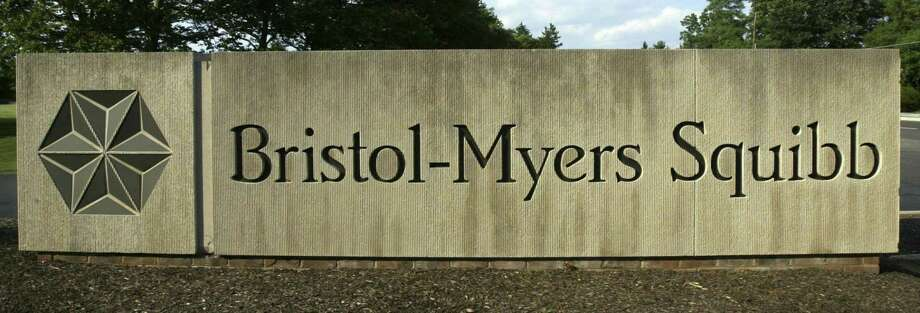 FILE - In this June 15 2005 file photo, a sign stands in front of the Bristol-Myers Squibb Company's headquarters in Lawrence Township, N.J. Researchers have scored the first big win against melanoma, the deadliest form of skin cancer. An experimental drug significantly improved survival in a major study of people with very advanced disease. The drug, ipilimumab, made by Bristol-Myers Squibb Co., works by helping the immune system fight tumors. (AP Photo/Mel Evans, File) Photo: Mel Evans / AP / AP