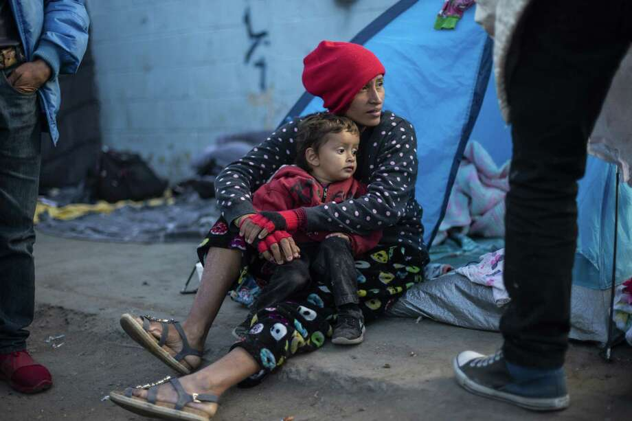 Central American migrants who have trekked for a month across Central America and Mexico in the hopes of reaching the United States, remain outside a temporary shelter in Tijuana, Baja California State, Mexico, near the border with the US, on Nov. 28. Photo: PEDRO PARDO /AFP /Getty Images / AFP or licensors