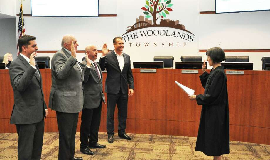 The newly re-elected quartet of incumbents on The Woodlands Township Board of Directors were sworn in for their new two-year terms on Wednesday night, Nov. 28, by Precinct 3 Justice of the Peace Edie Connelly. Pictured from left are Brian Boniface. Bruce Rieser, John Anthony Brown and Gordy Bunch. Photo: Courtesy Photograph/The Woodlands Township / Courtesy Photograph/The Woodlands Township