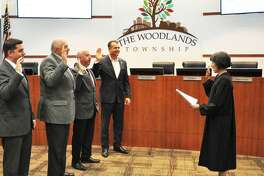 The newly re-elected quartet of incumbents on The Woodlands Township Board of Directors were sworn in for their new two-year terms on Wednesday night, Nov. 28, by Precinct 3 Justice of the Peace Edie Connelly. Pictured from left are Brian Boniface. Bruce Rieser, John Anthony Brown and Gordy Bunch.