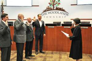 The newly re-elected quartet of incumbents on The Woodlands Township Board of Directors were sworn in for their new two-year terms on Wednesday night, Nov. 28, by Precinct 3 Justice of the Peace Edie Connelly. Pictured from left are Brian Boniface. Bruce Rieser, John Anthony Brown and Gordy Bunch. A proposal by State Rep. Steve Toth would shift township elections to even-numbered years and lengthen the terms of office from two years to four years.