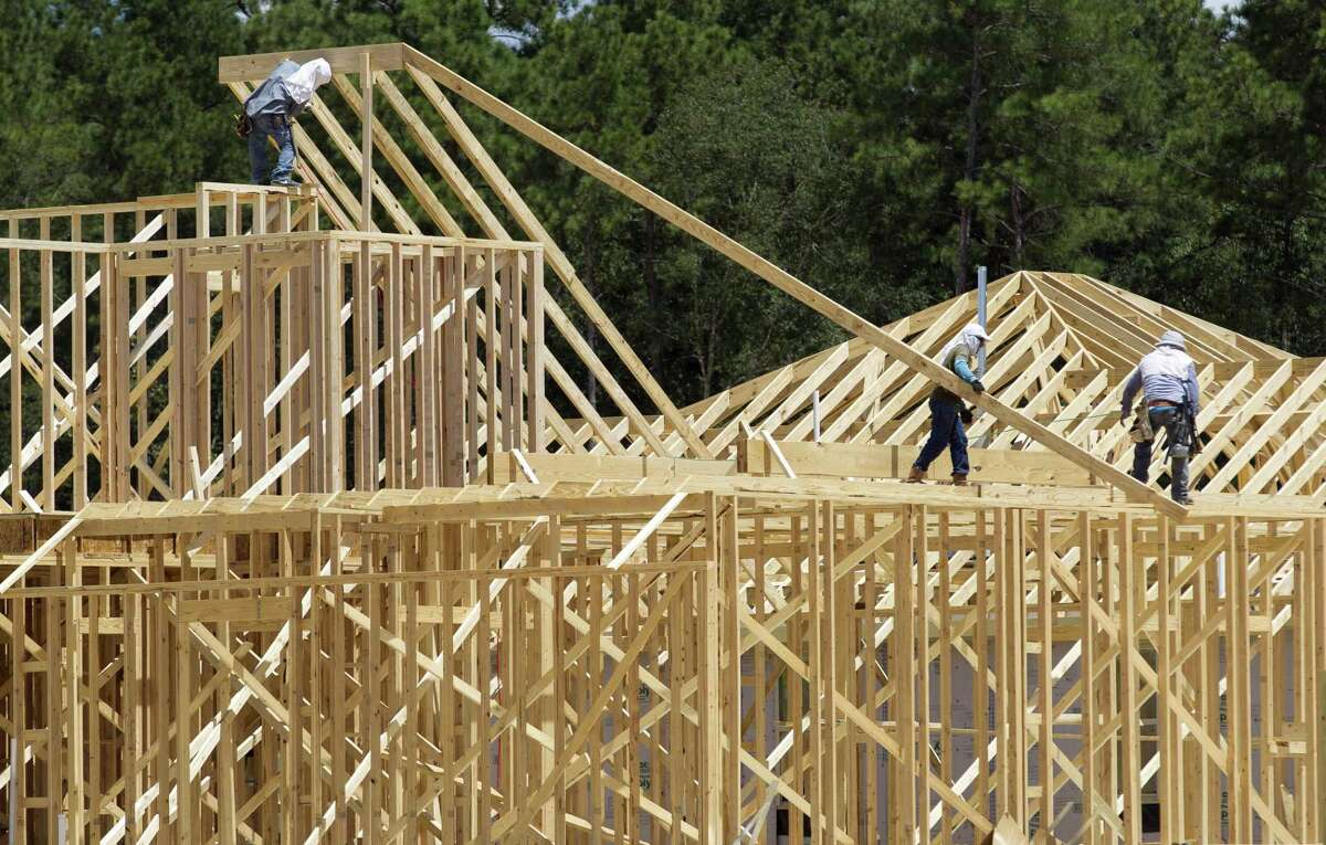Workers fame a home in the Ladera Creek subdivision, Tuesday, Aug. 22, 2017, in Conroe.