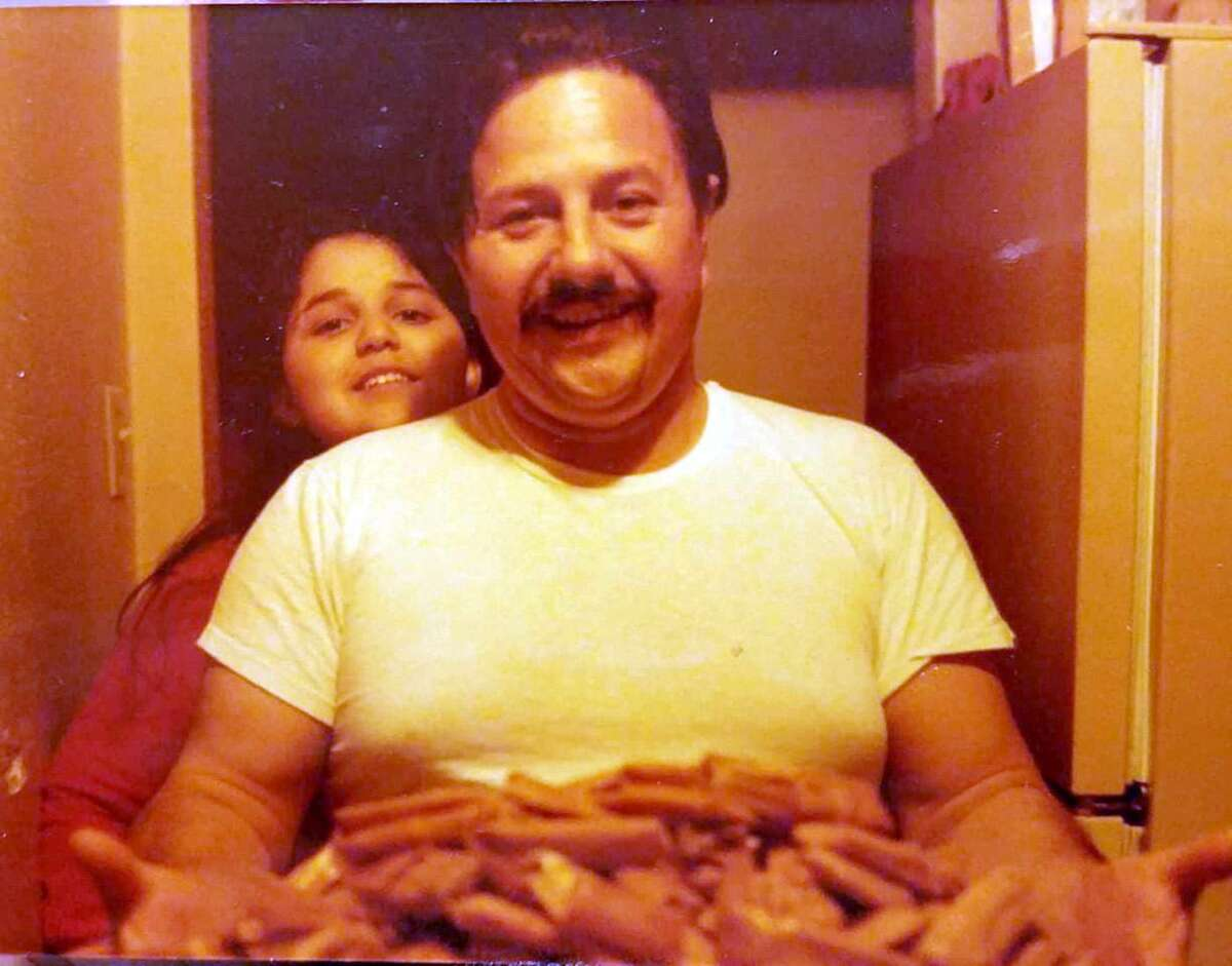 Brenda Téllez and her father, Luis Téllez, with a freshly made batch of tamales in the early 1980s.