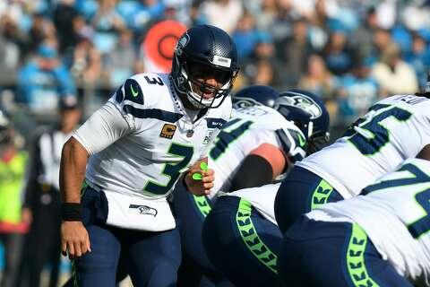 66817a08 <p>CHARLOTTE, NC - NOVEMBER 25: Seattle Seahawks quarterback Russell Wilson  (
