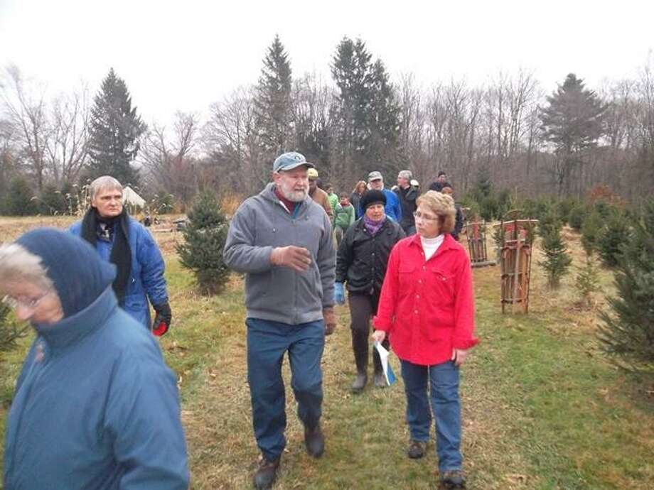 Kathy Hazen Downey, right, daughter of Reginald & Jesse Hazen, leading a tour of her family's Christmas tree farm. The Hazen family will host a walking tour of their tree farm on Sunday, Dec. 9 at 1 p.m. Photo: Contributed Photo / COPYRIGHT,2011