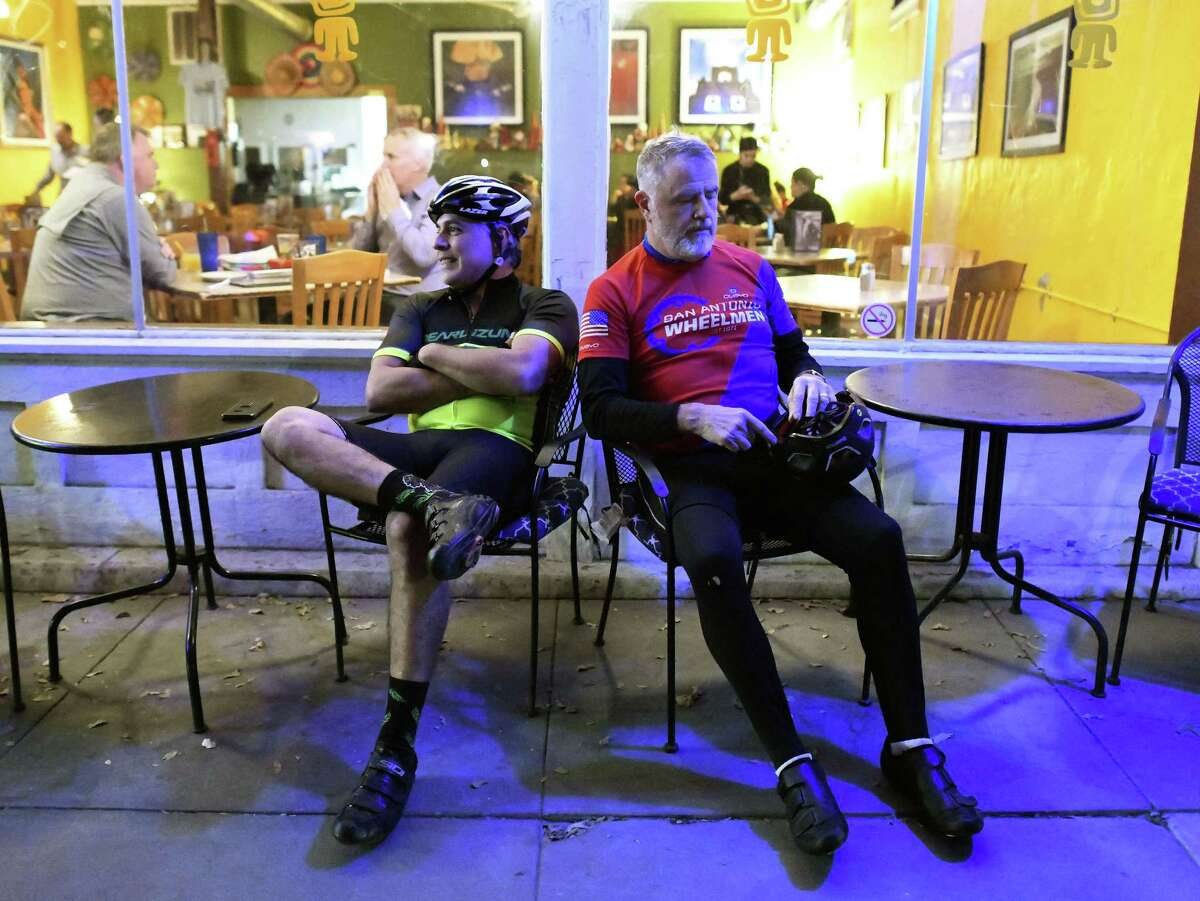 Thomas Arias, left, and Karl Kamin, members of the the San Antonio Gear Shifters bike group, gather at Tito's Mexican Restaurant on South Alamo Street on Thursday, Nov. 29, 2018. They have group rides twice a week.