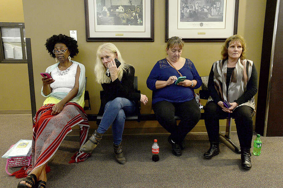 From left, Demetricia Holloway with the Surviving Parents crime victim support group sits with members of Larry Atwood's family, including his sister Shirley Harris, niece Alice Gipson and sister Faith Simmons as they await the jury verdict after hours of deliberation in the trial of Elizabeth Taylor. Photo taken Thursday, November 29, 2018 Kim Brent/The Enterprise Photo: Kim Brent/The Enterprise