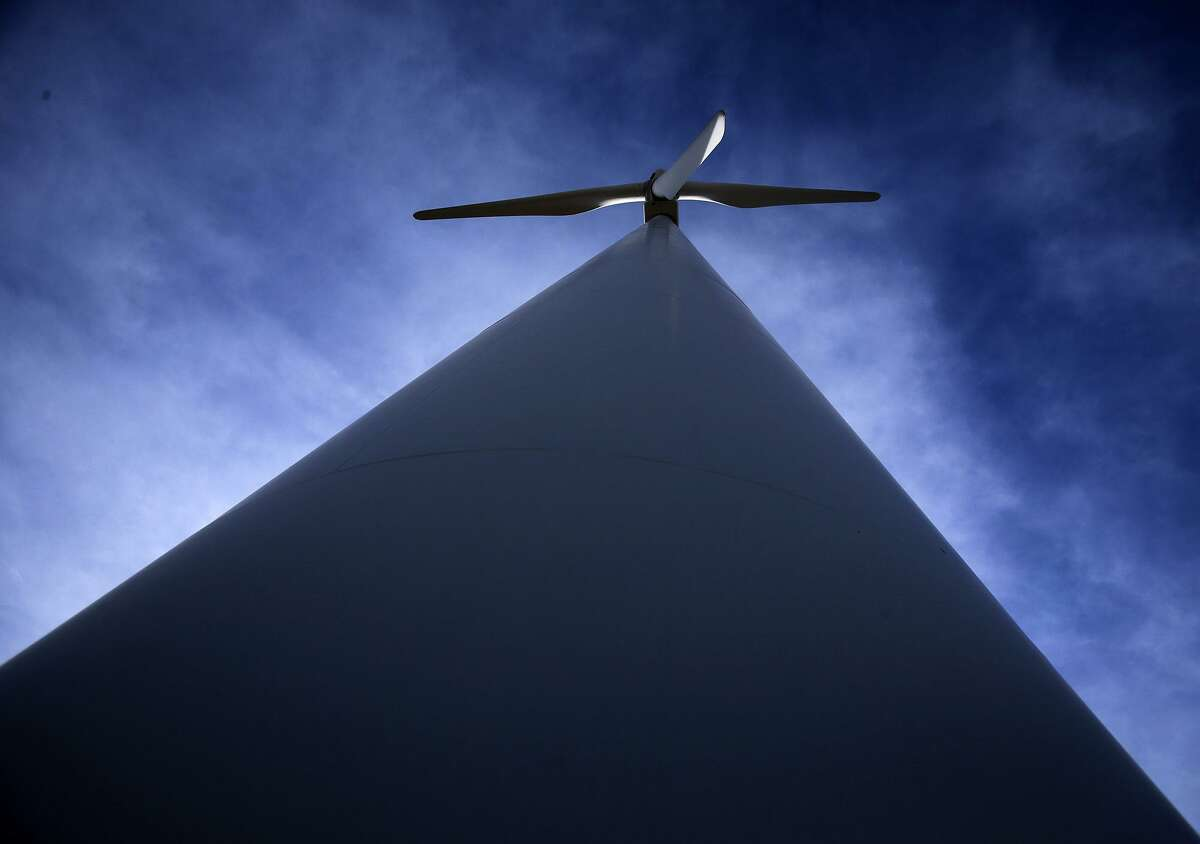 A wind turbine swirls near Fort StocktonAccess to transmission has been key to growth of wind power in Texas.