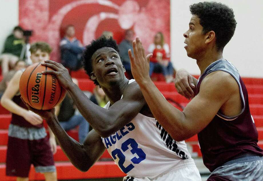 New Caney power forward Jaylen Neal (23) looks to shoot in the paint against Tarkington small forward Noah Torriente (3) in the second quarter of a high school basketball game during the 2018 Splendora Invitational at Splendora High School, Thursday, Nov. 29, 2018, in Splendora. Photo: Jason Fochtman, Houston Chronicle / Staff Photographer / © 2018 Houston Chronicle