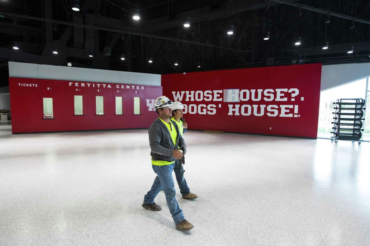 Work continues as the finishing touches are put on the new Fertitta Center at the University of Houston on Wednesday, Nov. 28, 2018, in Houston. The 7,100-seatn arena, formerly known as the Hofheinz Pavilion, has undergone a major transformation and will host its first home game against Oregon on Dec. 1, 2018.