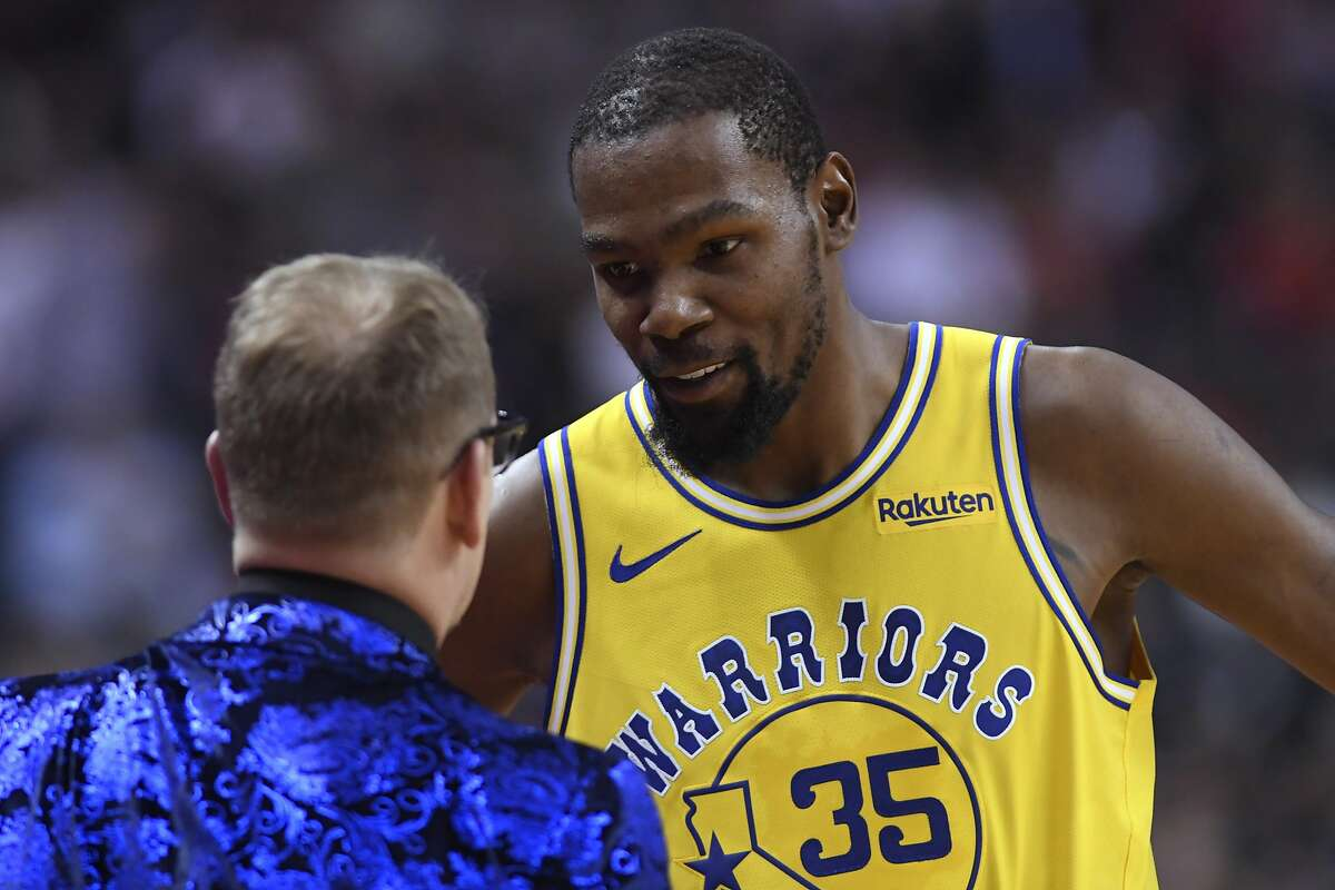 Golden State Warriors forward Kevin Durant (35) speaks with Toronto Raptors coach Nick Nurse during the first half of an NBA basketball game Thursday, Nov. 29, 2018, in Toronto. (Nathan Denette/The Canadian Press via AP)