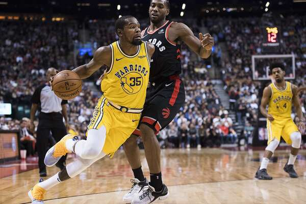 7ad2f5c6399d 3of16Golden State Warriors forward Kevin Durant (35) drives around Toronto  Raptors forward Kawhi Leonard (2) during the second half of an NBA  basketball ...