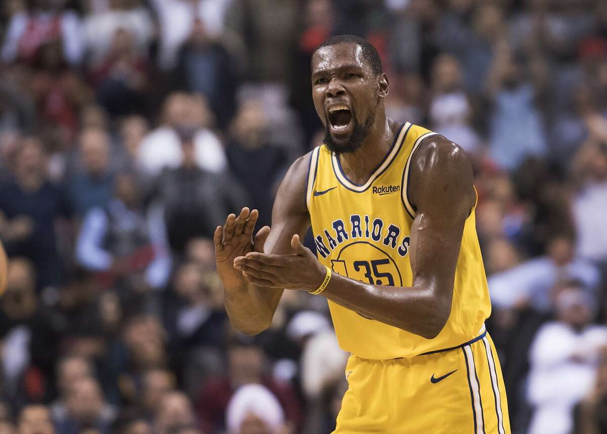 Golden State Warriors forward Kevin Durant reacts to a call during overtime of the team's NBA basketball game against the Toronto Raptors on Thursday, Nov. 29, 2018, in Toronto. (Nathan Denette/The Canadian Press via AP)