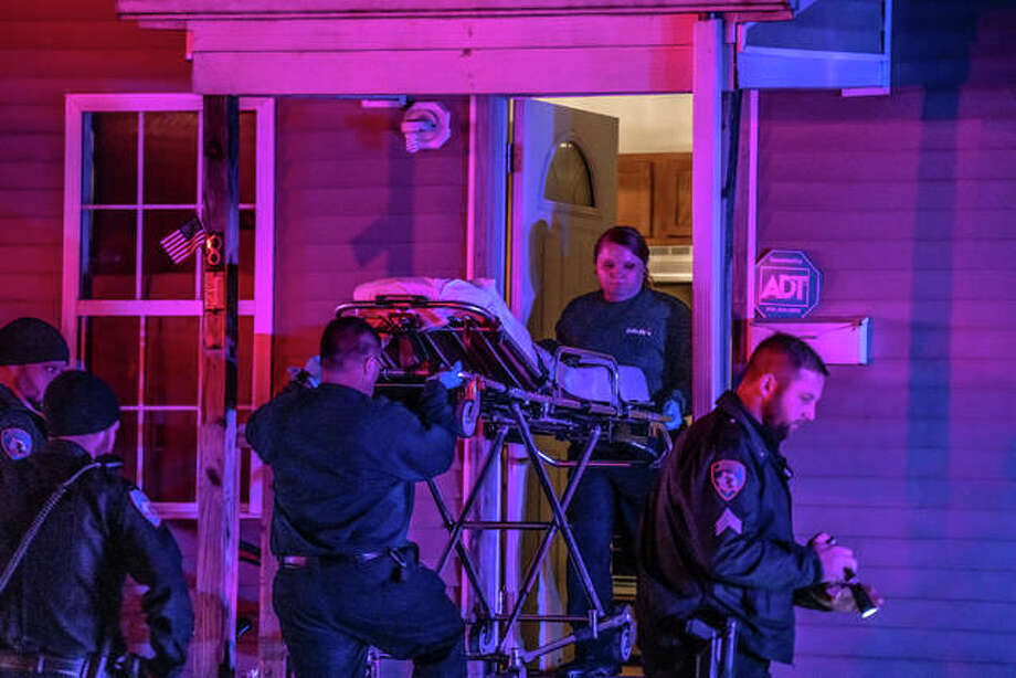The report of a gunshots and a man hit sent Alton police, fire and rescue to the 800 block of Ridge Street Thurday night. The call came in around 10 p.m. Initial police radio traffic indicated that a suspect vehicle — an SUV with a broken windshield — was headed in the direction of Brown Street. The victim, a white adult male, was conscious and alert when transported to the hospital. His injuries did not appear to be life threatening. Anyone with possible information regarding the incident is encouraged to contact the Alton Polive Department at 618-463-3505. Photo: Nathan Woodside | The Telegraph