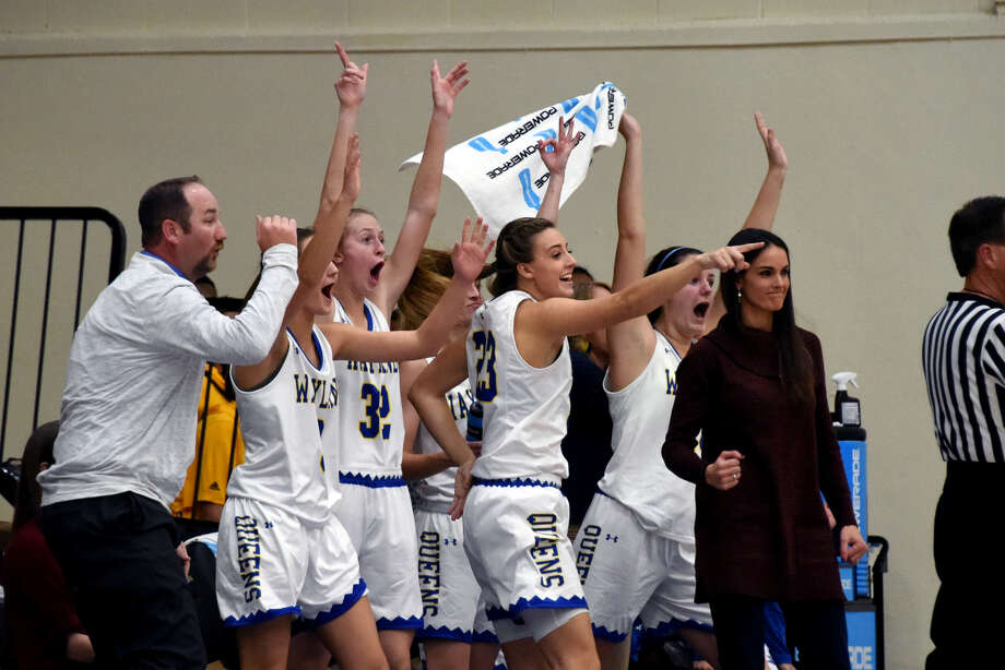 The No. 6-ranked Wayland Baptist Flying Queens bench, assistant coach Josh Bailey (left) and head coach Alesha Ellis (far right) celebrate during the Flying Queens' Sooner Athletic Conference game against the USAO on Thursday night at Hutcherson Center in Plainview. Photo: Claudia Lusk/Wayland Baptist University
