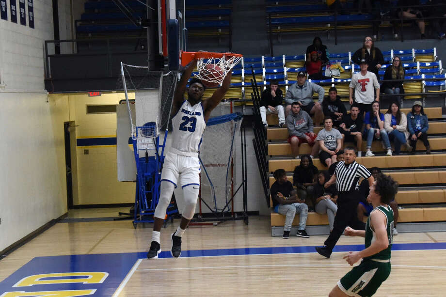 No. 20-ranked Wayland Baptist Pioneers senior guard Trevonta Robertson dunks the basketball on a fast break opportunity against USAO on Thursday night at Hutcherson Center in Plainview. Photo: Claudia Lusk/Wayland Baptist University