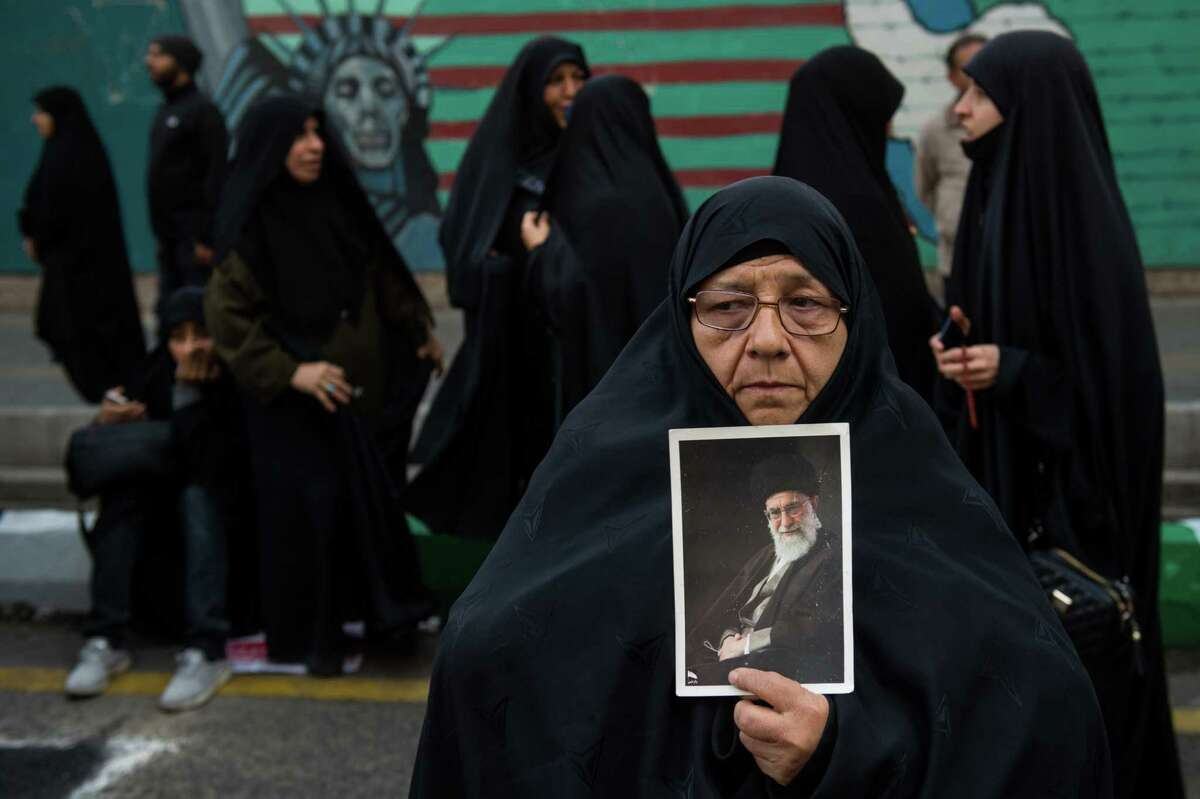A woman holds a picture of Ayatollah Khamenei, Iran's supreme leader during a demonstration on the anniversary of the U.S. embassy seizure, in Tehran, Iran, on Nov. 4, 2018.