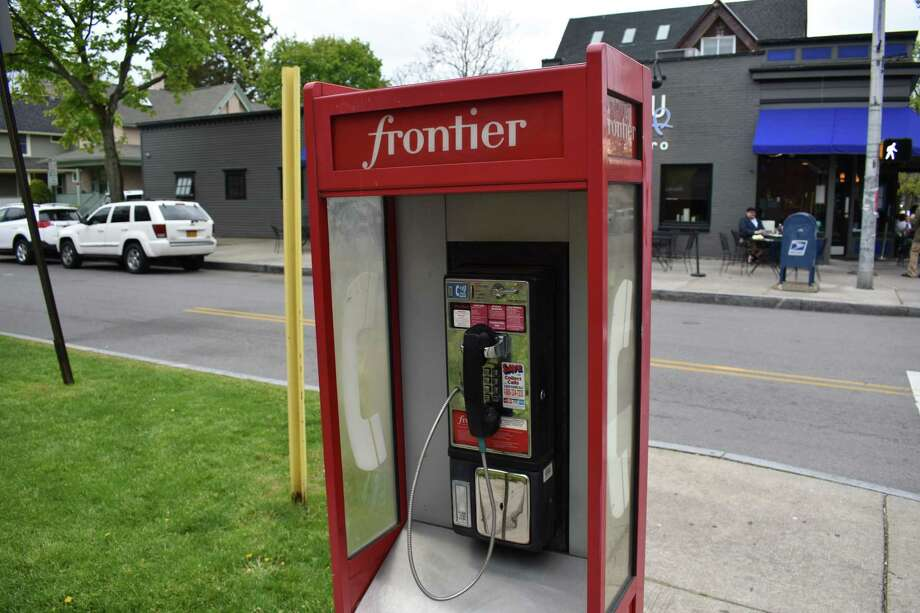 A Frontier Communications coin pay phone in Rochester, N.Y., in May 2017. After asking New York regulators that year for permission to end blanket distribution of telephone books there, Connecticut regulators signaled plans entering December 2018 to follow suit. Photo: Alexander Soule / Hearst Connecticut Media / Stamford Advocate