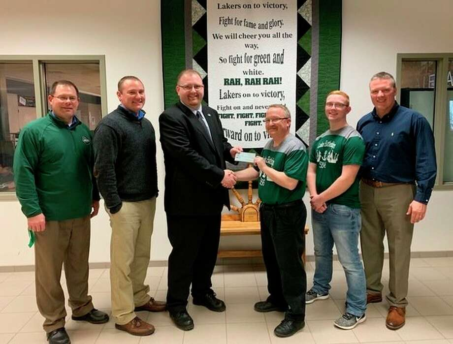 Pictured are, from left, Laker Secondary School Principal Jon Good, Laker Technology Director Scott Miklovic, Mr. Schaefer, Laker High School teacher and FIRST Robotics Coach Scott Lebsack, FIRST Robotics team member Aaron Baranski and Laker Superintendent Brian Keim. (Submitted Photo)