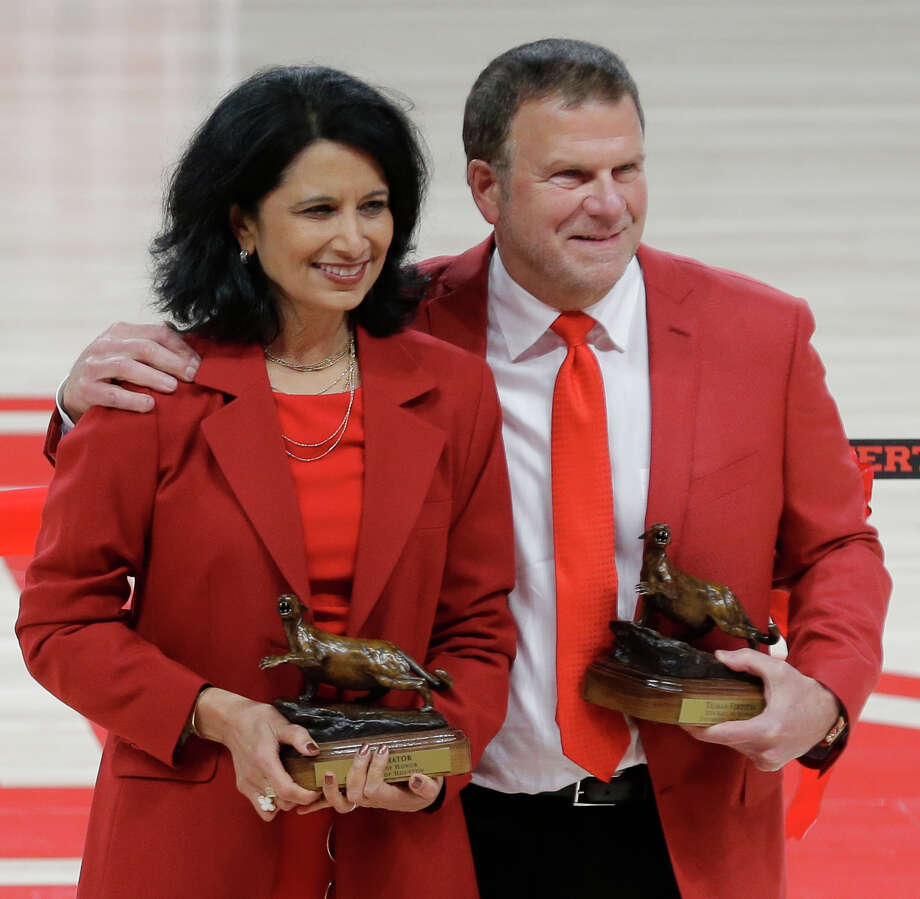 Renu Khator, University of Houston president, left, and Tilman Fertitta, chairman of the University of Houston System Board of Regents, right, were inducted into the UH Athletics Hall of Honor.