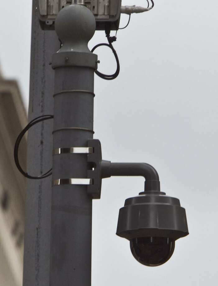 A network of surveillance cameras similar to this one in Houston will be installed in The Woodlands under an agreement between the township and the Montgomery County Office of Homeland Security and Emergency Management. The program costs $300,000, which is completely paid for by federal grants. INitially, officials said, 15 to 20 cameras will be place on light poles in highly travelled areas of the township. Photo: James Nielsen, Staff / Houston Chronicle / Houston Chronicle