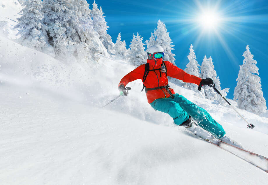 When buying skiwear, look for fabric that is water- and wind-resistant. Look for wind flaps to shield zippers, snug cuffs at wrists and ankles, collars that can be snuggled up to the chin and drawstrings that can be adjusted for comfort and keep wind out. Be sure to buy quality clothing, helmets and other products. Photo: Shutterstock