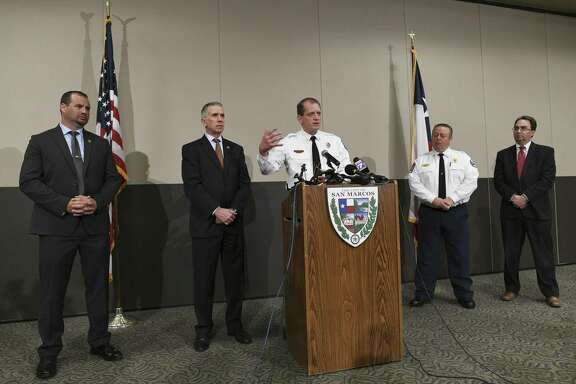 Mike Weddell, left, and Fred Milanowski, both of the federal Bureau of Alcohol, Tobacco, Firearms and Explosives; San Marcos Fire Marshal Kelly Kistner, at podium, Fire Chief Les Stephens and Hays County District Attorney Wes Mau hold a press conference Nov. 30, 2018, about the Iconic Village Apartments fire in San Marcos. They said the fire, which killed five people, was intentionally set.