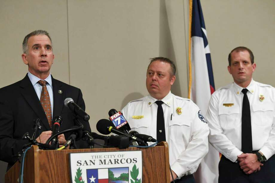 Fred Milanowski of the ATF speaks as Fire Chief Les Stephens and fire marshal Kelly Kistner, right, of San Marcos listen during a press conference about the Iconic Village apartments fire, which happened on July 20, on Friday, Nov. 30, 2018. They announced that the fire, which killed five people, was intentionally set. Photo: Billy Calzada, Staff Photographer / San Antonio Express-News