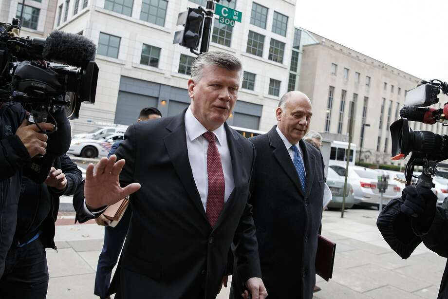 Attorneys Kevin Downing (left) and Thomas Zehnle, who represent ex-Trump aide Paul Manafort, leave the courthouse in Washington. They deny that Manafort lied to prosecutors. Photo: Carolyn Kaster / Associated Press