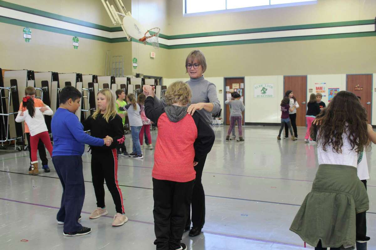 The nonprofit organization Dancing Thru Life, headquartered in The Woodlands, began a ballroom dancing club at Glen Loch Elementary last year. It was the first school in Conroe ISD to implement the program. Instructor and retired Glen Loch math teacher Judy Wechter dances with a student.