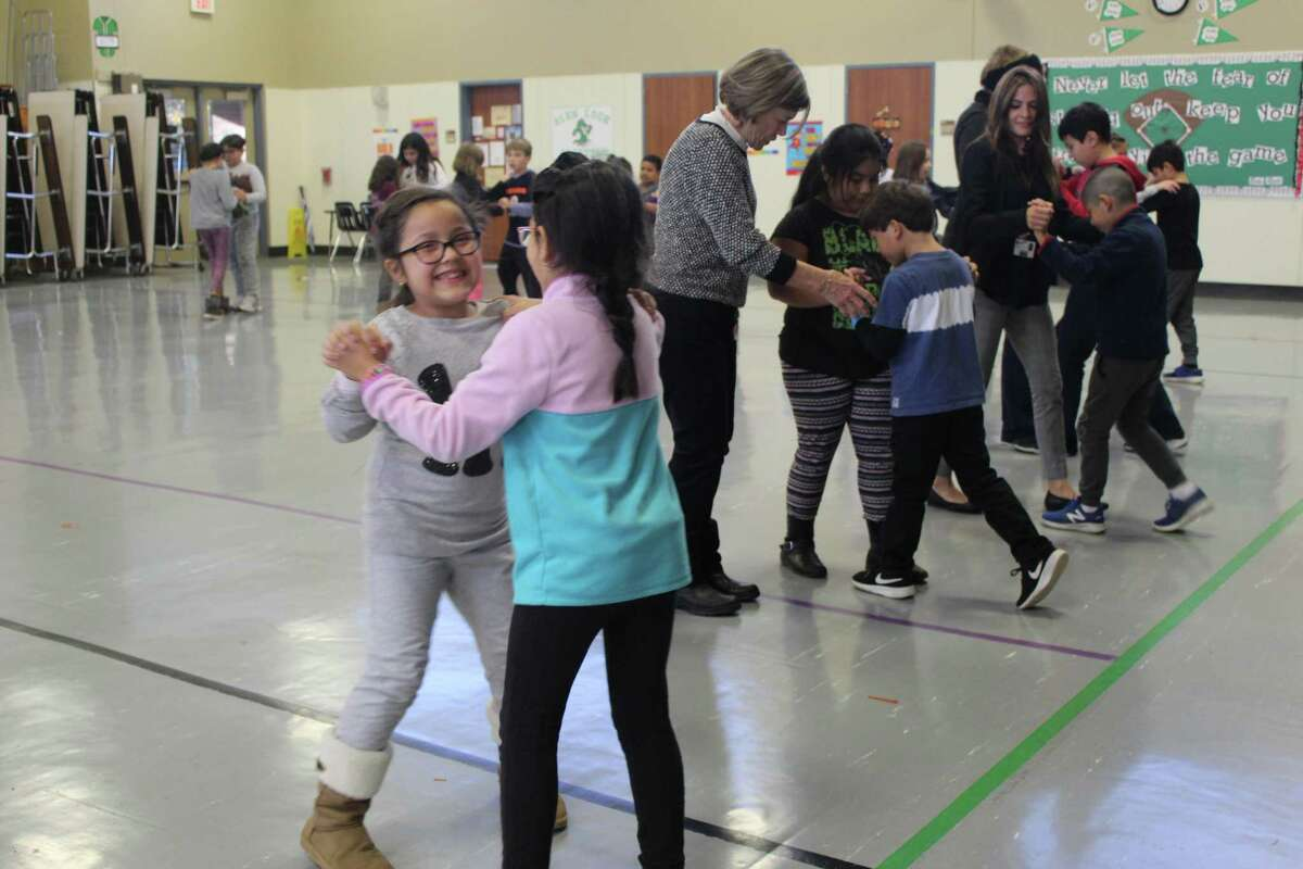 The nonprofit organization Dancing Thru Life, headquartered in The Woodlands, began a ballroom dancing club at Glen Loch Elementary last year. It was the first school in Conroe ISD to implement the program. Instructor and retired Glen Loch math teacher Margarita Zubieta helps students learn a dance.