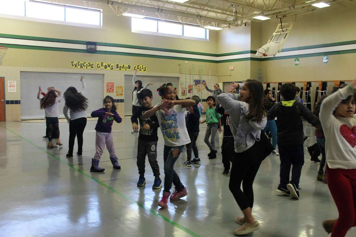 The nonprofit organization Dancing Thru Life, headquartered in The Woodlands, began a ballroom dancing club at Glen Loch Elementary last year. It was the first school in Conroe ISD to implement the program. Here, the students perform a flash mob.