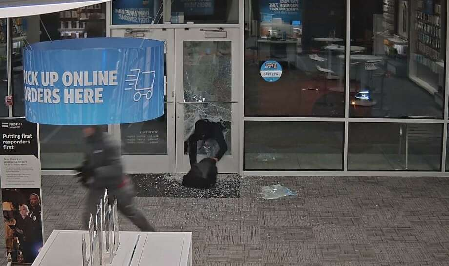 PHOTOS: Houston suspects caught on camera Video footage shows suspects breaking in to an AT& store in Cypress on Thursday, Nov. 29.>>>Keep clicking for Houston crimes caught on camera... Photo: Courtesy Of Mark Herman, Harris County Constable Precinct 4 Facebook Page
